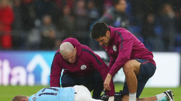 Kevin De Bruyne is tended to by Manchester City's medical staff