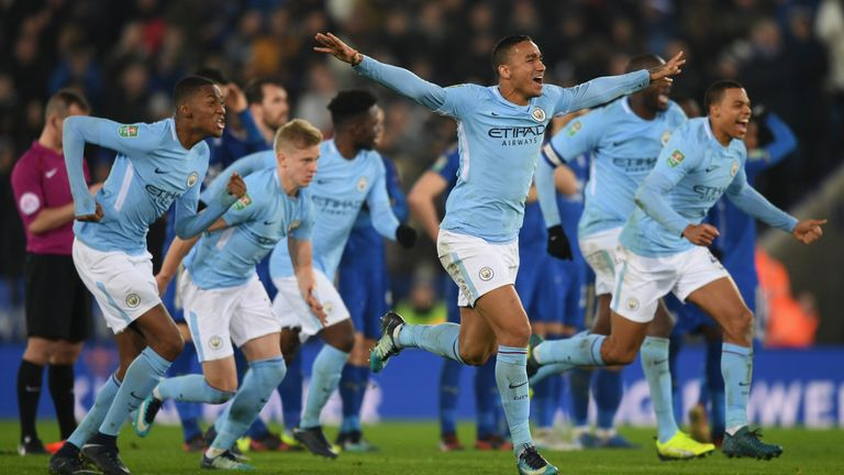 Manchester City players celebrate their penalty shootout win at Leicester