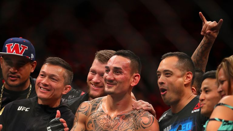 Holloway celebrates victory with his team and family