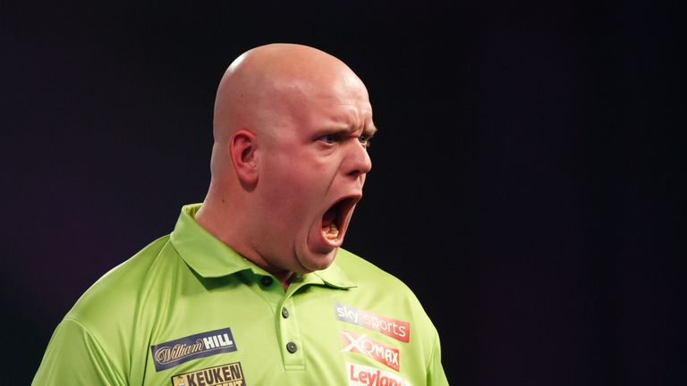 Michael van Gerwen celebrates during his match against Gerwyn Price on day eleven of the William Hill World Darts Championship