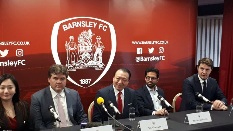 Grace Hung (left), Paul Conway (second left) and Chien Lee (centre) at a press conference at Oakwell