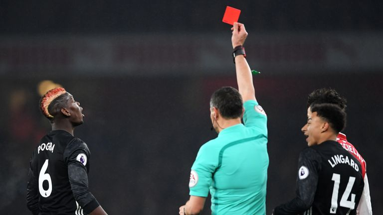 Paul Pogba is shown a red card by referee Andre Marriner for a dangerous tackle on Hector Bellerin