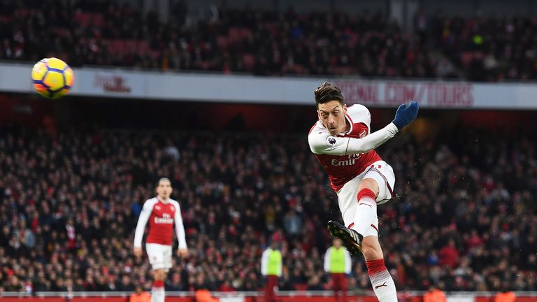Mesut Ozil's left-footed volley sealed Arsenal's victory over Newcastle