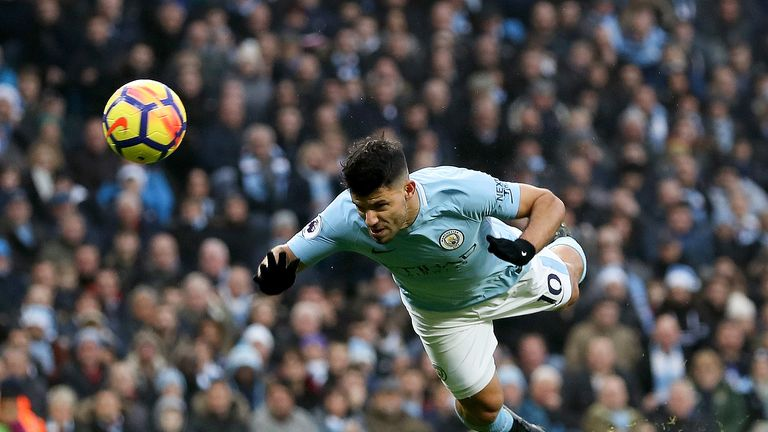 Sergio Aguero makes it 1-0 with a diving header