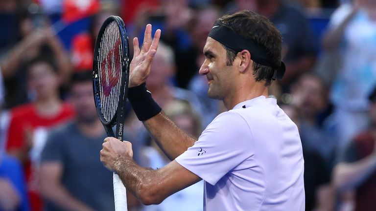 Roger Federer celebrates after easing to victory in his Hopman Cup opener