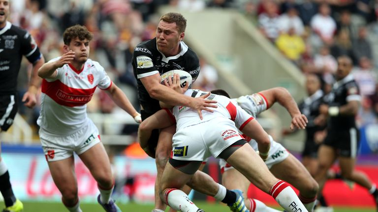 Scott Taylor of Hull FC is tackled by Mitch Allgood of Hull KR, who has since joined St George Illawarra Dragons