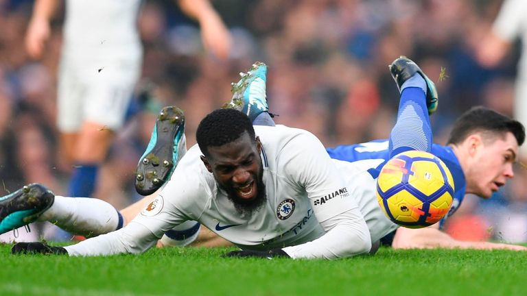 Tiemoue Bakayoko goes down under a challenge from Michael Keane