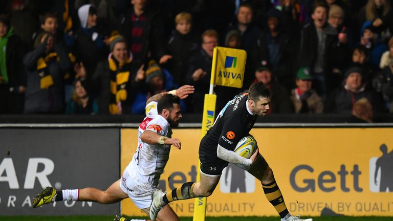 Elliot Daly goes over to score Wasps' third try against the Tigers
