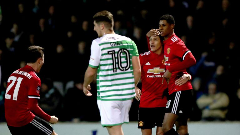 Marcus Rashford celebrates his goal with new Manchester United team-mate Alexis Sanchez