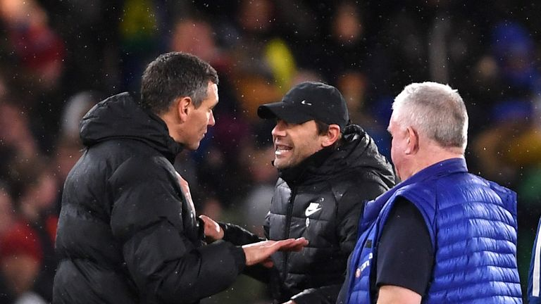 Conte argues with the fourth official at full-time