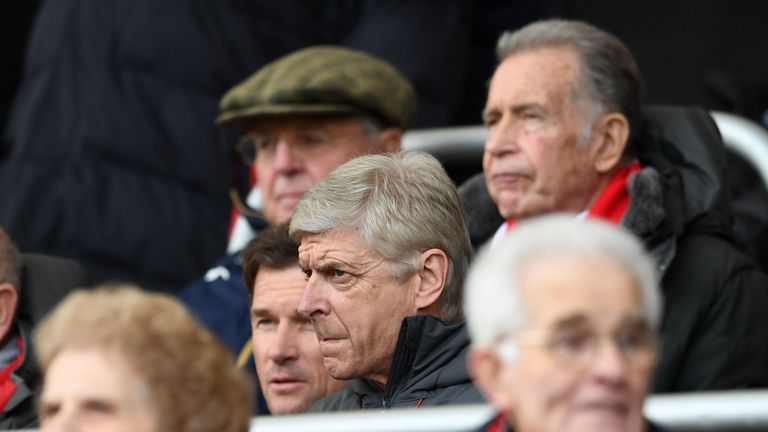 A grim-faced Arsene Wenger serves the final game of his touchline ban during Arsenal's defeat at Bournemouth