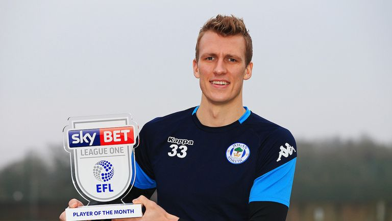 Dan Burn of Wigan Athletic is presented with the Sky Bet Player of the Month award
