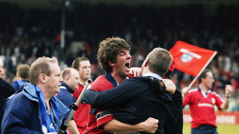 O'Callaghan celebrates with Munster supporters in 2003. 'I bleed red', he tells us