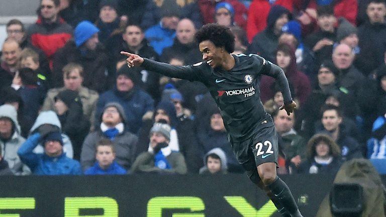 Willian celebrates his goal at Brighton