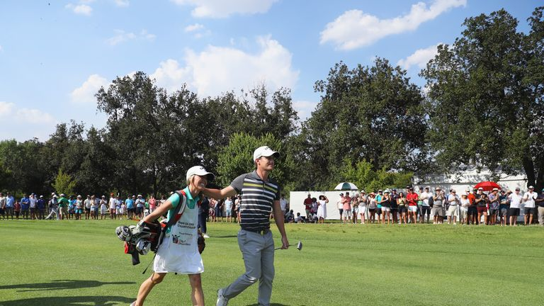 Paisley celebrates with his wife and caddie Keri walking down the 18th green