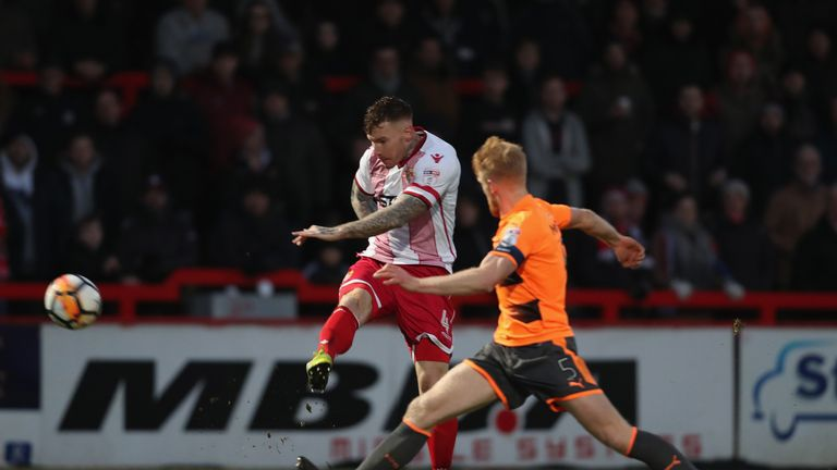 Jack King of Stevenage volleys his shot past Paul McShane of Reading in Saturday's stalemate
