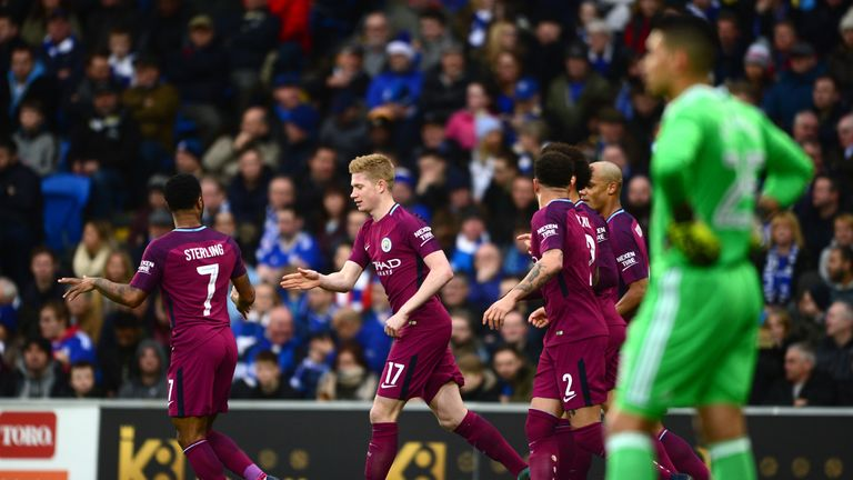 Kevin De Bruyne (centre) celebrates after opening the scoring with a cheeky free-kick