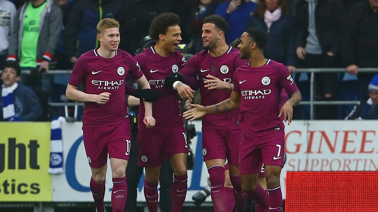Kevin De Bruyne (left) celebrates with his Man City team-mates