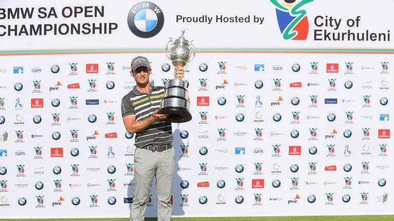 Chris Paisley proudly displays the BMW SA Open trophy