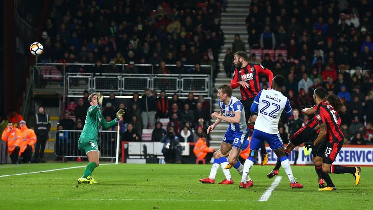 Steve Cook's late header earned Bournemouth a replay after coming from two goals down to draw with Wigan