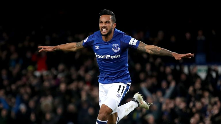 Theo Walcott celebrates after scoring his first Everton goal against Leicester