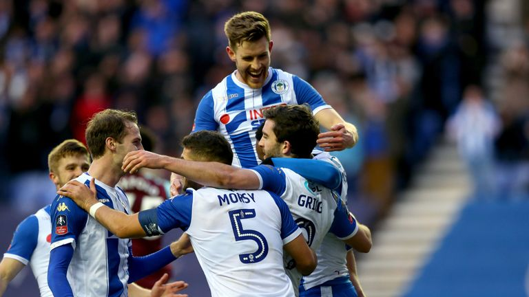 Wigan celebrate knocking West Ham out of the FA Cup