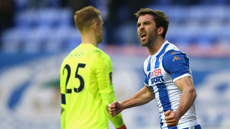 Will Grigg celebrates after scoring Wigan's second goal against West Ham
