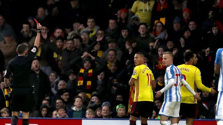 Referee Michael Oliver shows a red card to Troy Deeney