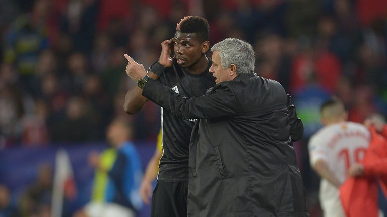Jose Mourinho gives instructions to Manchester United midfielder Paul Pogba