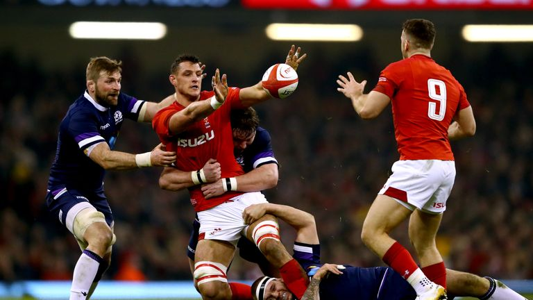 Aaron Shingler looks to offload as he is tackled by Jon Welsh and Gordon Reid