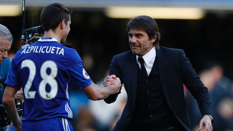 Chelsea head coach Antonio Conte with Cesar Azpilicueta (L)
