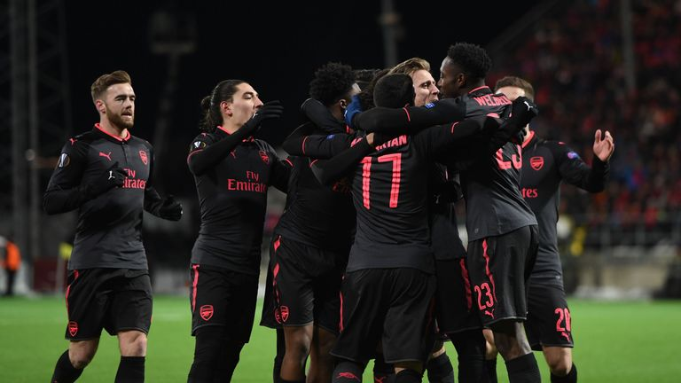 Arsenal players celebrate after scoring Monreal's opener against Ostersunds