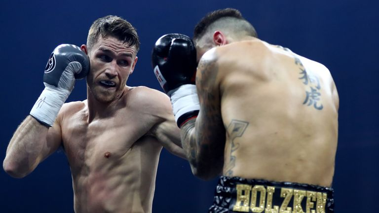 Callum Smith (left) gets stuck into Nieky Holzken in Germany on Saturday night