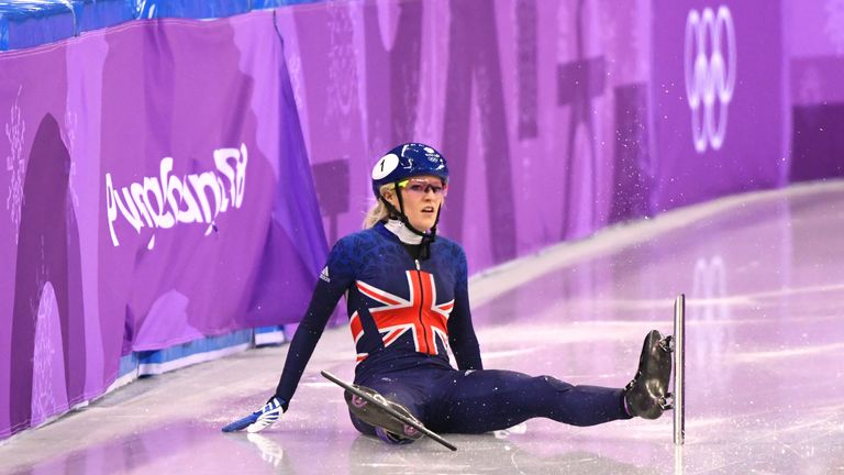 Christie looks on after crashing out of the 500m short track final