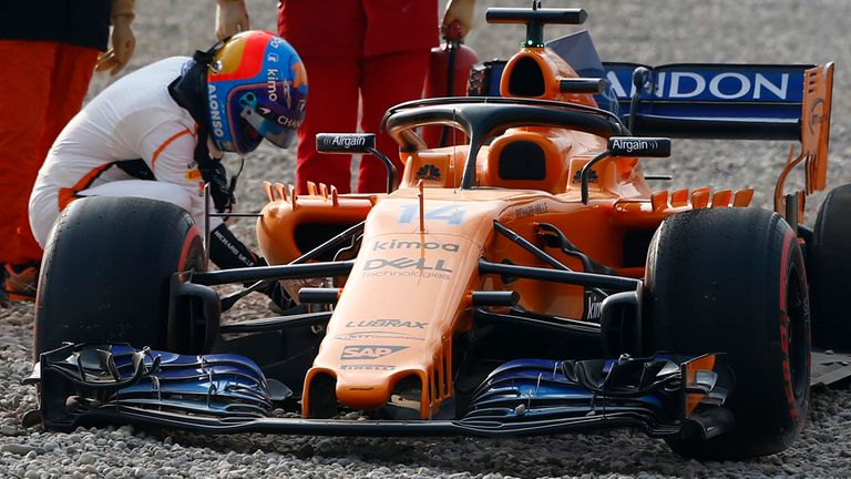 fernando alonso crashes mclaren early in barcelona winter testing