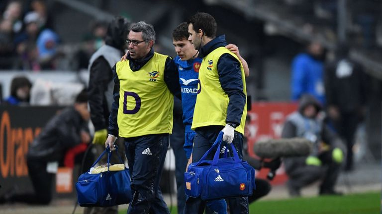 France's Antoine Dupont is led off the field after being injured against Ireland