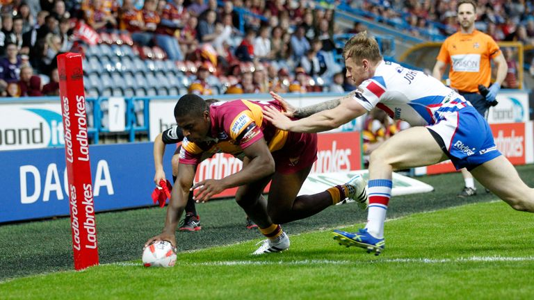 Jermaine McGillvary of Huddersfield Giants scores against Wakefield