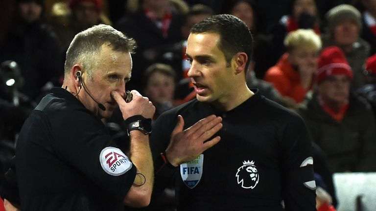 Jon Moss consulted with assistant referee Eddie Smart over a penalty decision