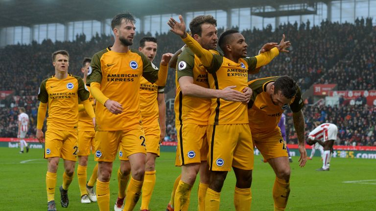 Jose Izquierdo (right) celebrates after opening the scoring for Brighton