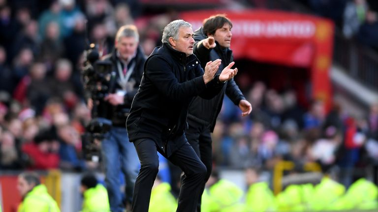 Jose Mourinho and Antonio Conte give their teams instructions during the Premier League match at Old Trafford