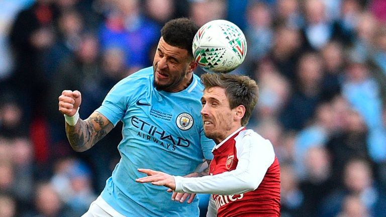 Kyle Walker and Nacho Monreal battle during the first half