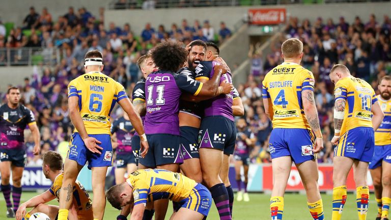 Melbourne's Jesse Bromwich is congratulated by his team-mates after scoring a try during the World Club Challenge match