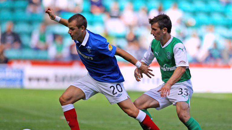 Miller (right) during his time at Hibernian challenges Vladimir Weiss of Rangers
