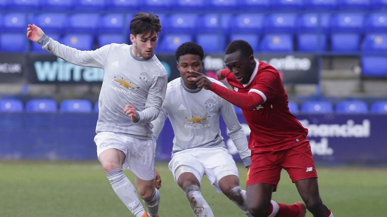 Liverpool's Bobby Adekanye races clear of two United players