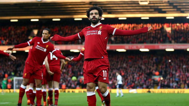 Mohamed Salah celebrates after scoring the first of his two goals against Spurs