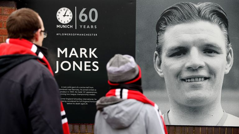 Fans look at the memorial before the game