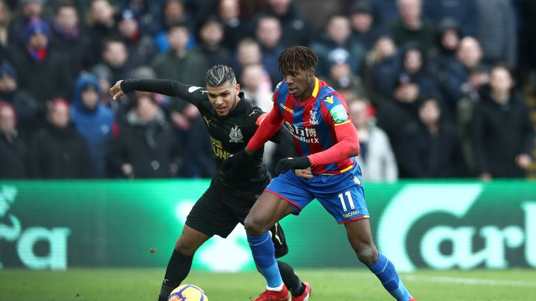 Wilfried Zaha (right) was injured against Newcastle but remained on the pitch