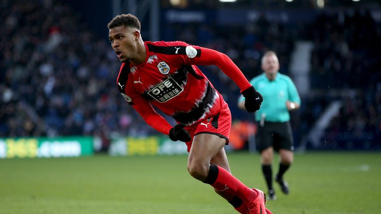 Steve Mounie celebrates scoring Huddersfield's second goal against West Brom at The Hawthorns