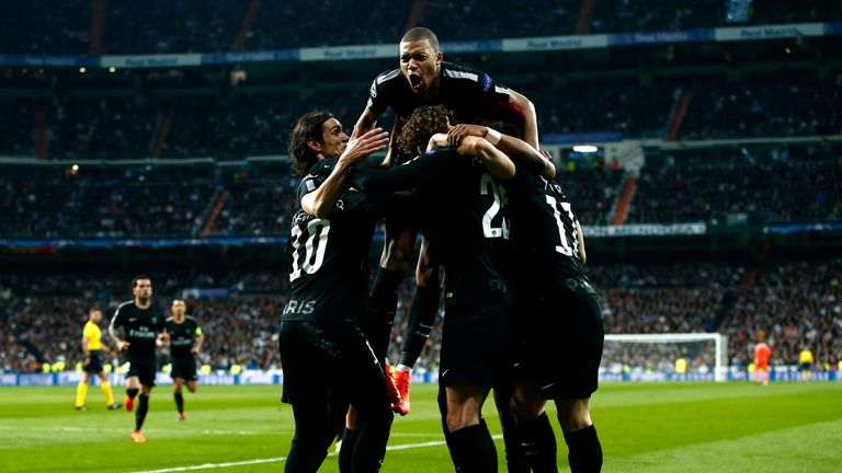 PSG's players celebrate their late equaliser
