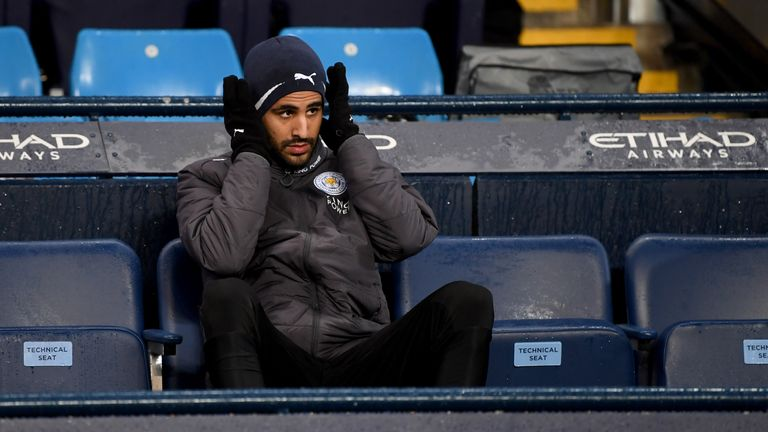 Riyad Mahrez looks on from the Leicester City bench at the Etihad Stadium